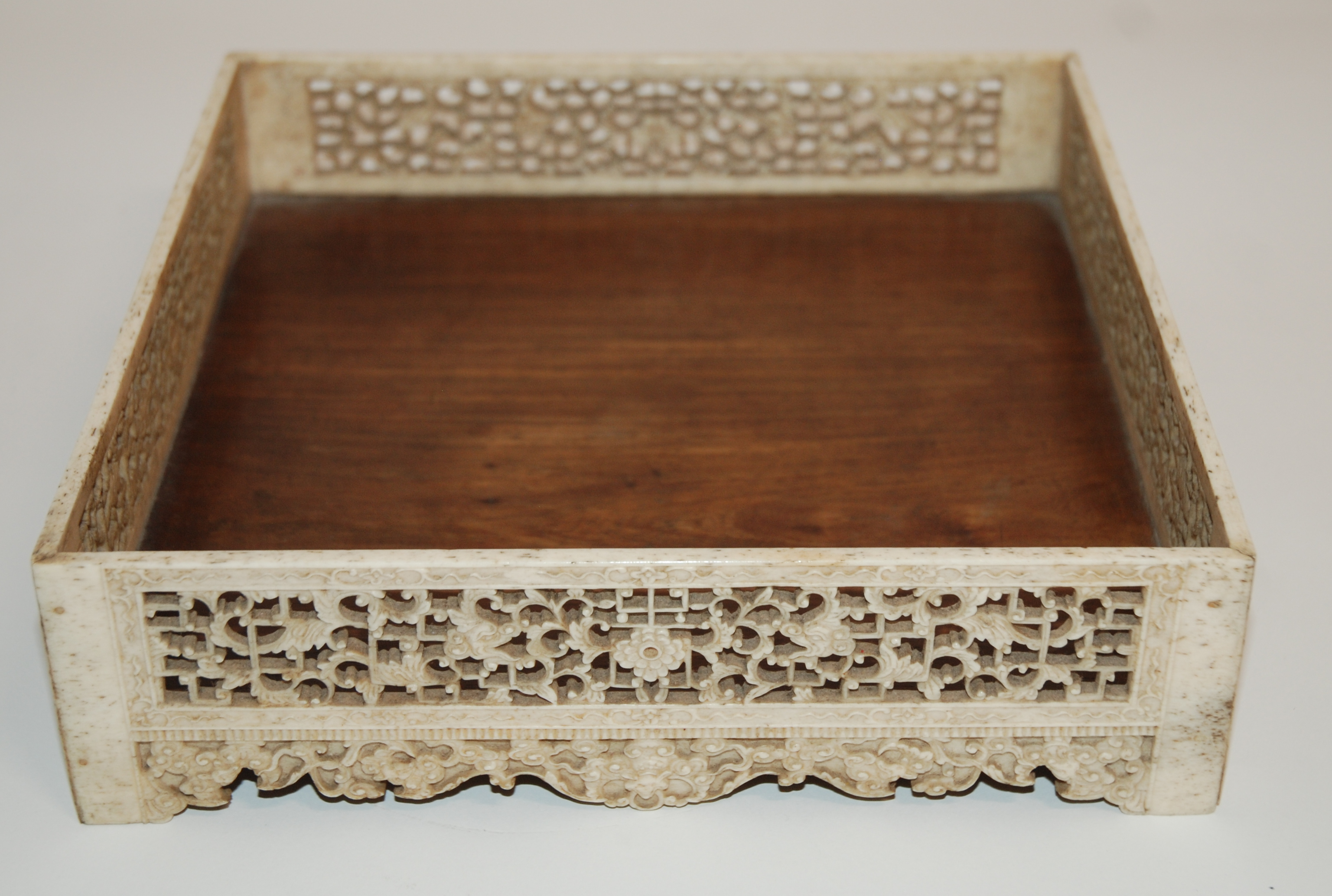 Lot 21 - A RARE CHINESE MARINE IVORY AND HUANGHUALI SQUARE TRAY the sides finely carved with foliate