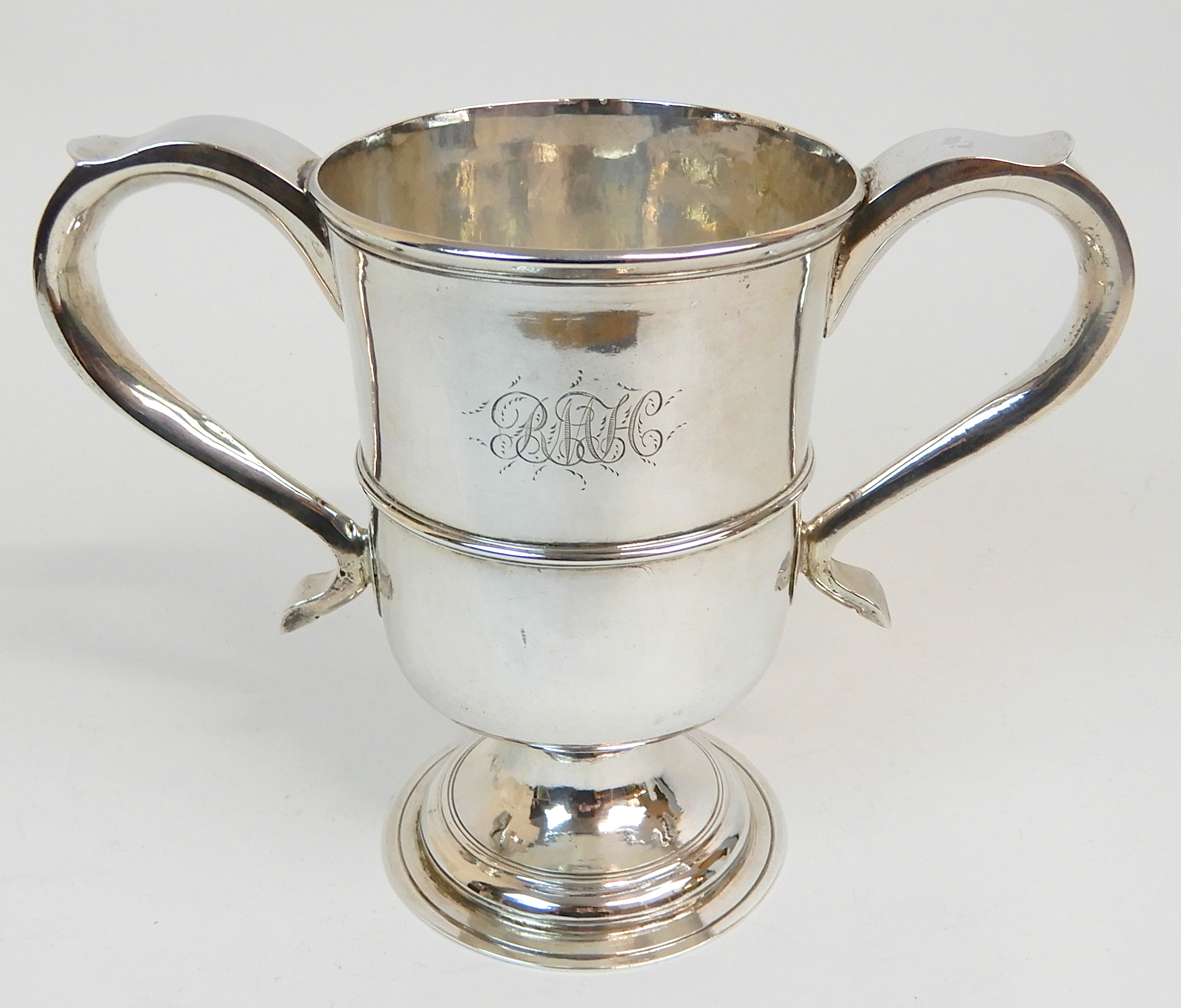 Lot 121 - A GEORGE III SILVER TROPHY CUP by Dorothy Langlands, Newcastle 1811, of cylindrical form with