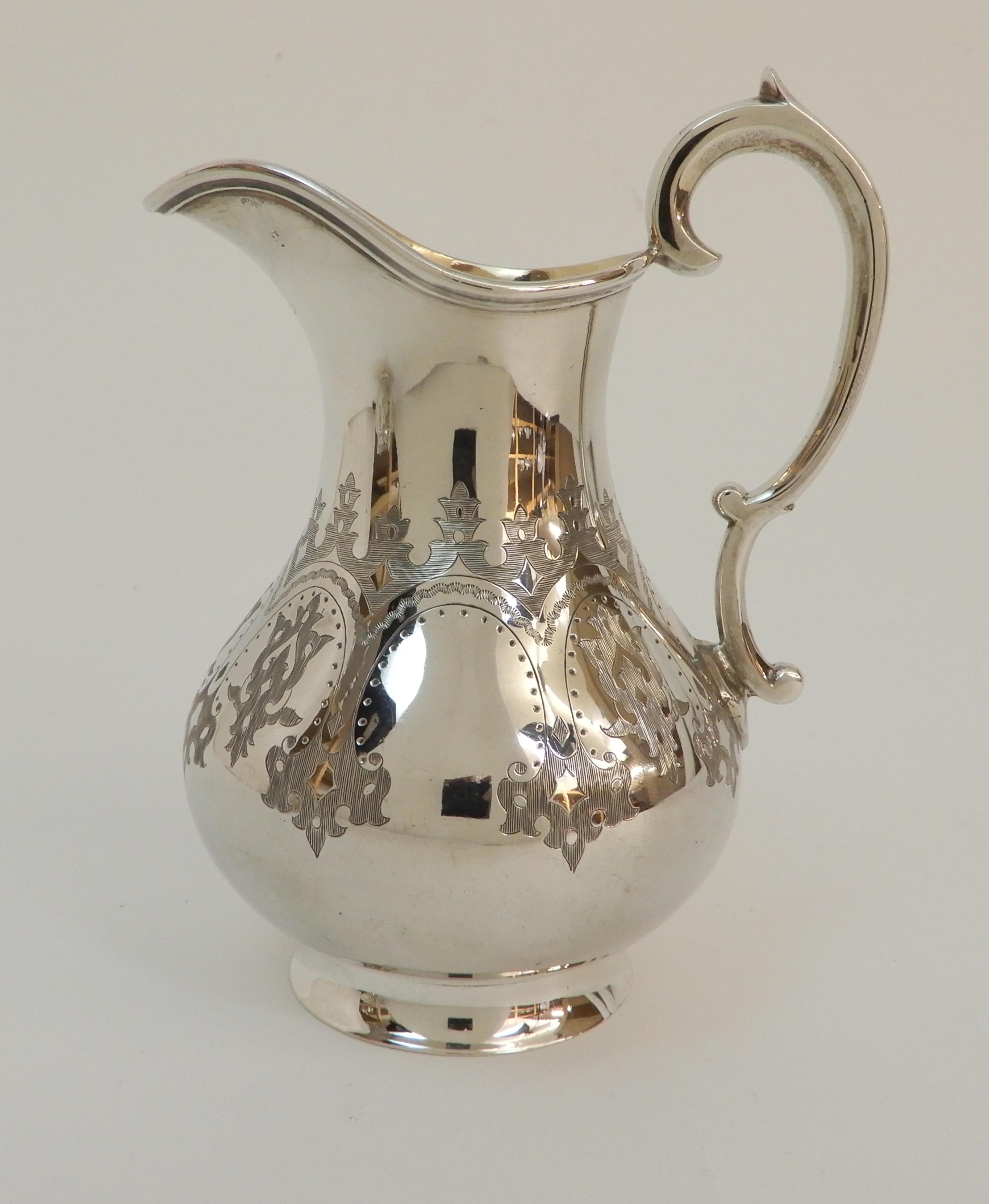 Lot 154 - A MATCHED VICTORIAN SILVER THREE PIECE TEA SERVICE by Robert Harper, London 1867, the cream jug