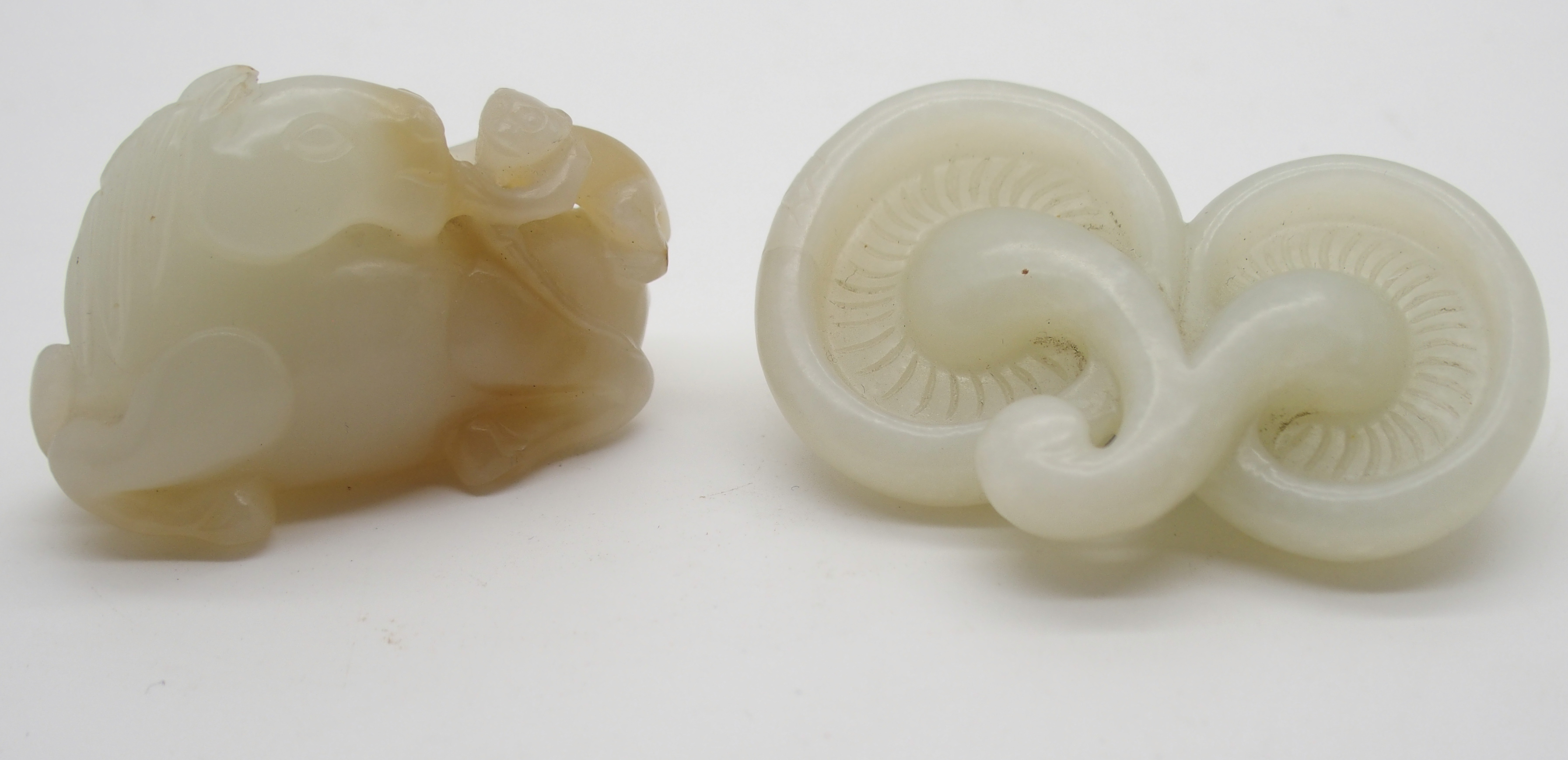 Lot 23 - A CHINESE JADE ANIMAL CARVING with a recumbent horse and monkey climbing on its back, 5cm wide and