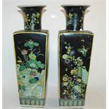 A PAIR OF CHINESE FAMILLE NOIRE SQUARE SHAPED VASES painted with storks amongst aquatic foliage, six