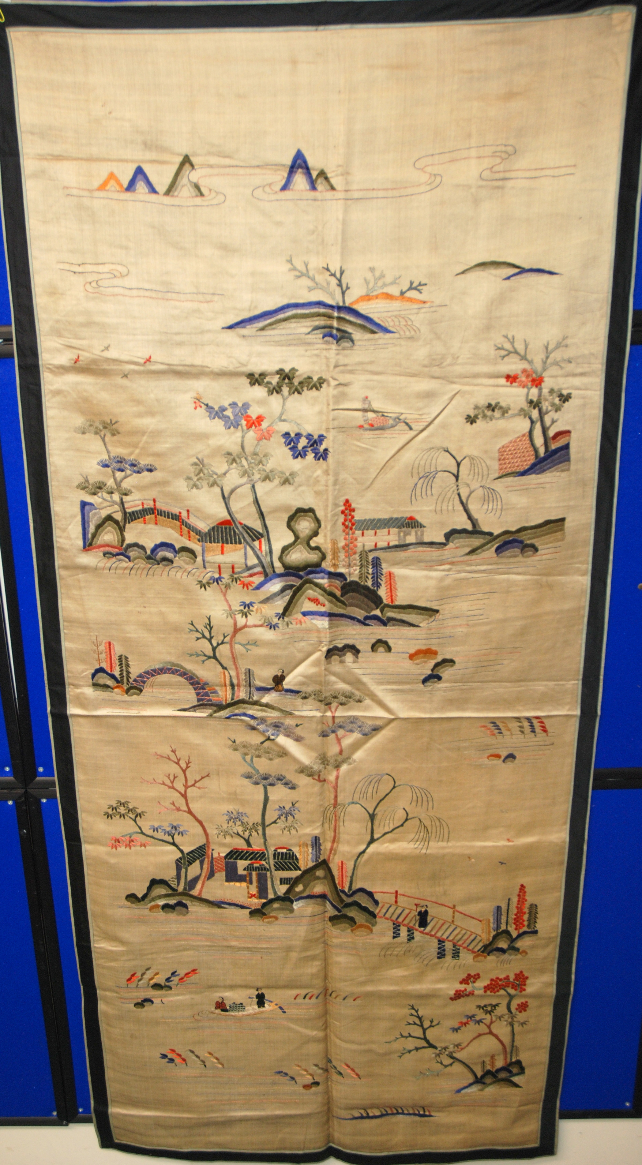 Lot 1 - A PAIR OF CHINESE SILK PANELS each embroidered with sampans amongst river islands, 163 x 73cm and