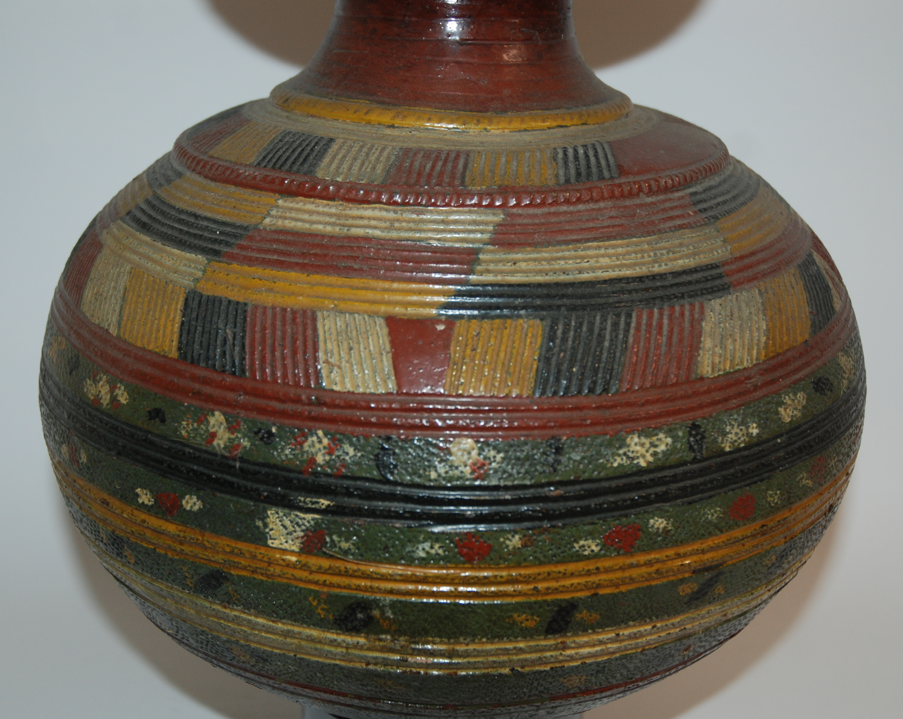 Lot 15 - A NIGERIAN POTTERY GOURD SHAPED VESSEL incised and painted with geometric banding in colours, 36cm