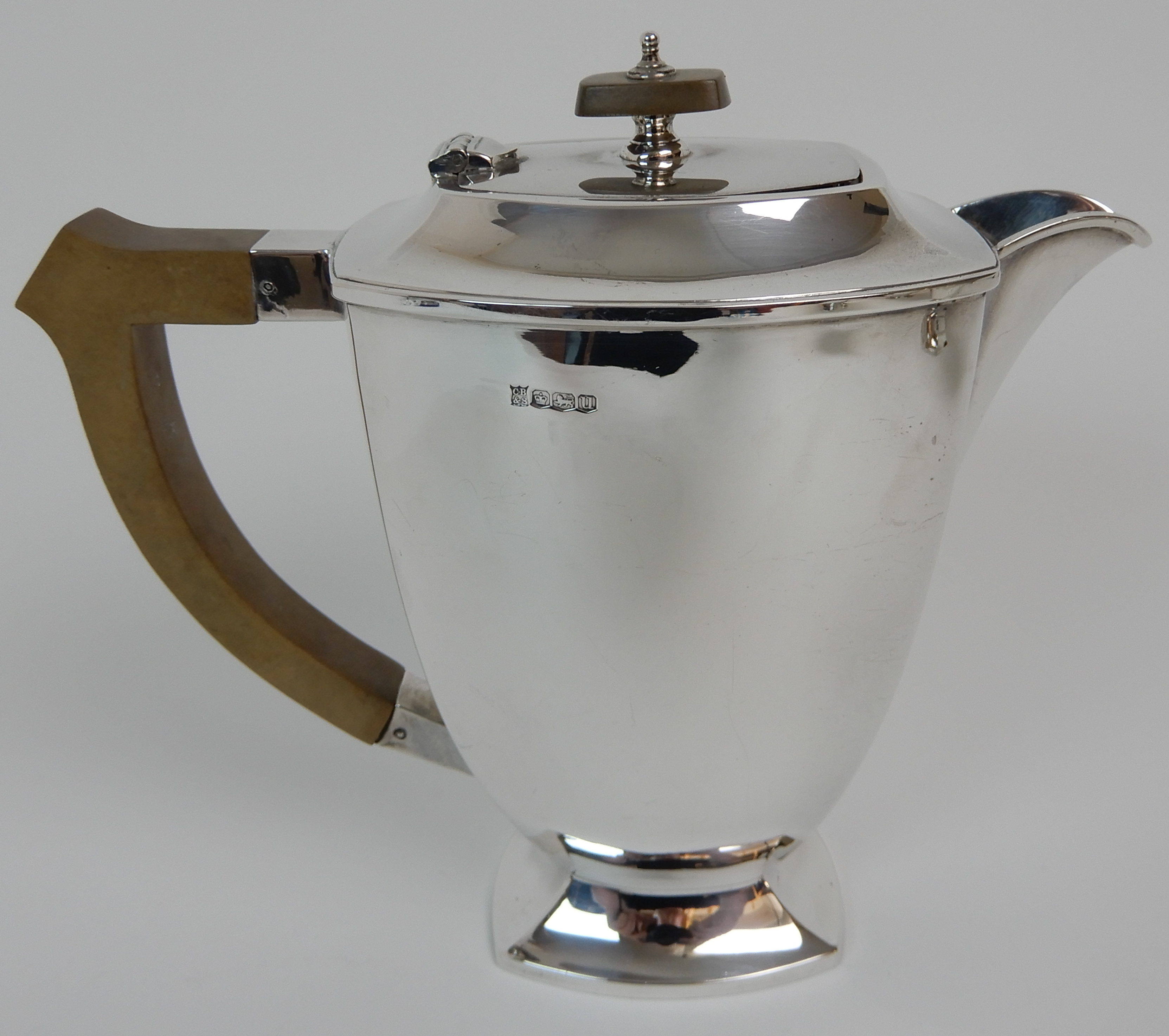 Lot 160 - A FOUR PIECE SILVER TEA SERVICE by Cooper Brothers & Sons Limited, Sheffield 1936 and 1937 of