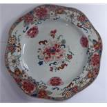 A late 18thC Chinese famille rose porcelain plate with a wavy border 9''dia