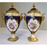 A pair of late 19th/early 20thC Coalport china ovoid shaped pedestal vases with rams' head handles