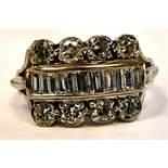 A white coloured metal eight stone diamond ring