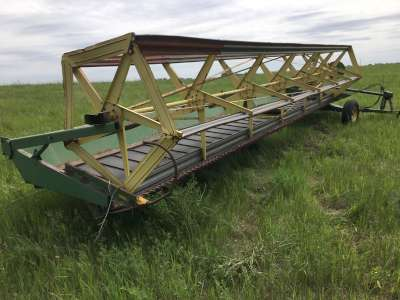 Lot 27 - JD #590 pto swather, 25ft, straight table