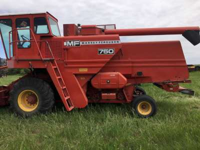 Lot 22 - MF 750 Combine less than 2000 threshing hrs,always stored inside,w/new fuel pump(Comes with