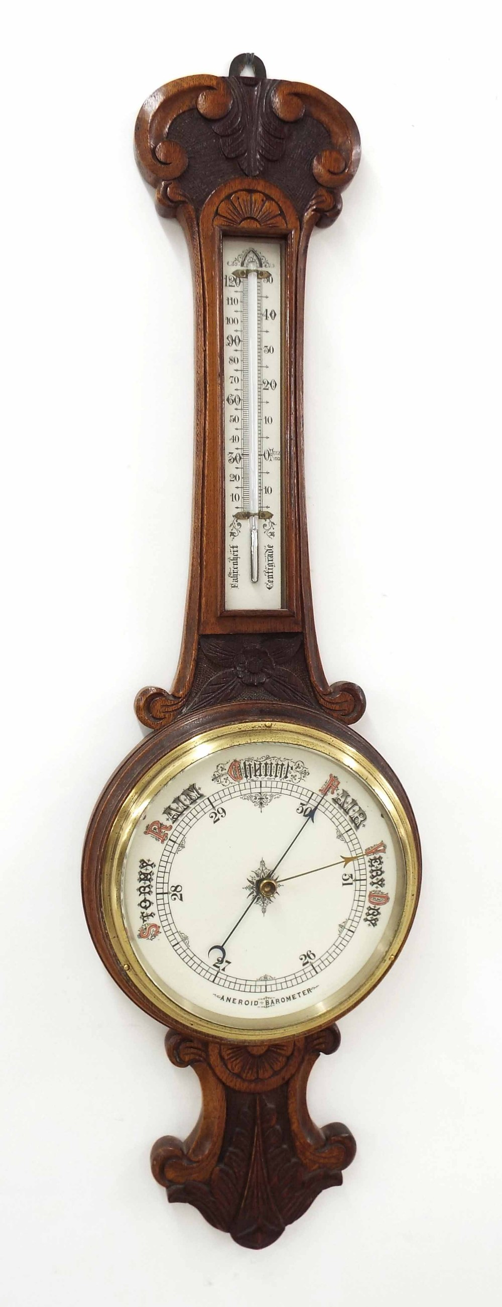 Lot 1020 - Oak aneroid barometer/thermometer within a foliate carved case