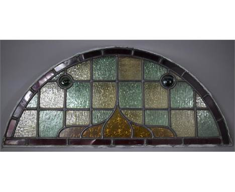 A Vintage Arched Top Stained Glass Window or Door Light, 79cm wide and 36cm high