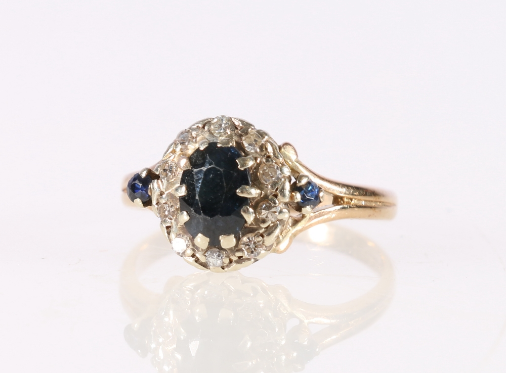 Lot 57 - 9ct yellow gold diamond and sapphire ladies dress ring, 3g, size O.
