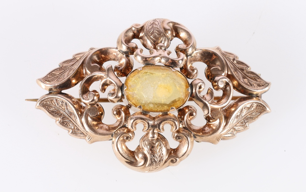 Lot 11 - Unhallmarked Victorian yellow metal brooch set with central cabochon stone, 8.8g