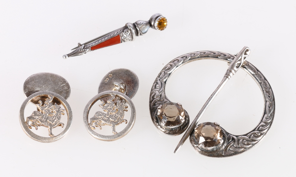 Lot 25 - Scottish silver penannular brooch with Celtic knott border and two faceted quartz stones by maker JG
