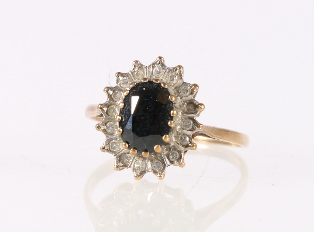 Lot 55 - 9ct yellow gold diamond and central faceted sapphire set flowerhead ring, 1.8g, size M.