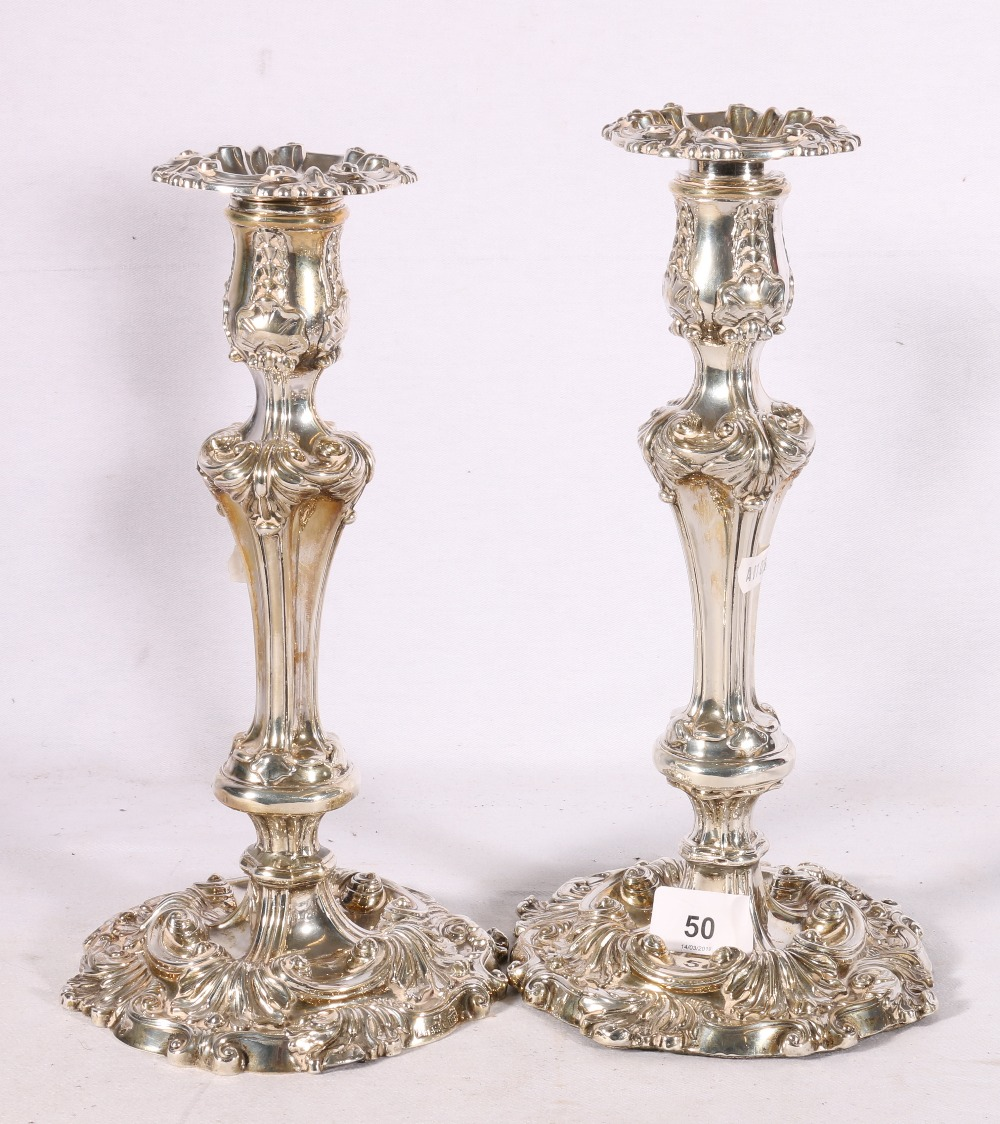 Lot 50 - A pair of Victorian Silver candlesticks, Sheffield 1886,  Hawkesworth, Eyre & co, 1680g.