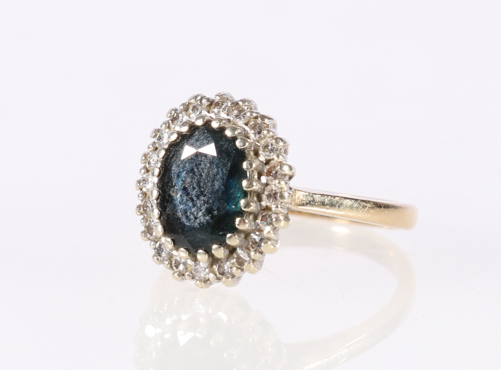 Lot 54 - 9ct yellow gold diamond and central faceted sapphire flowerhead ring, 3.4g, size J.