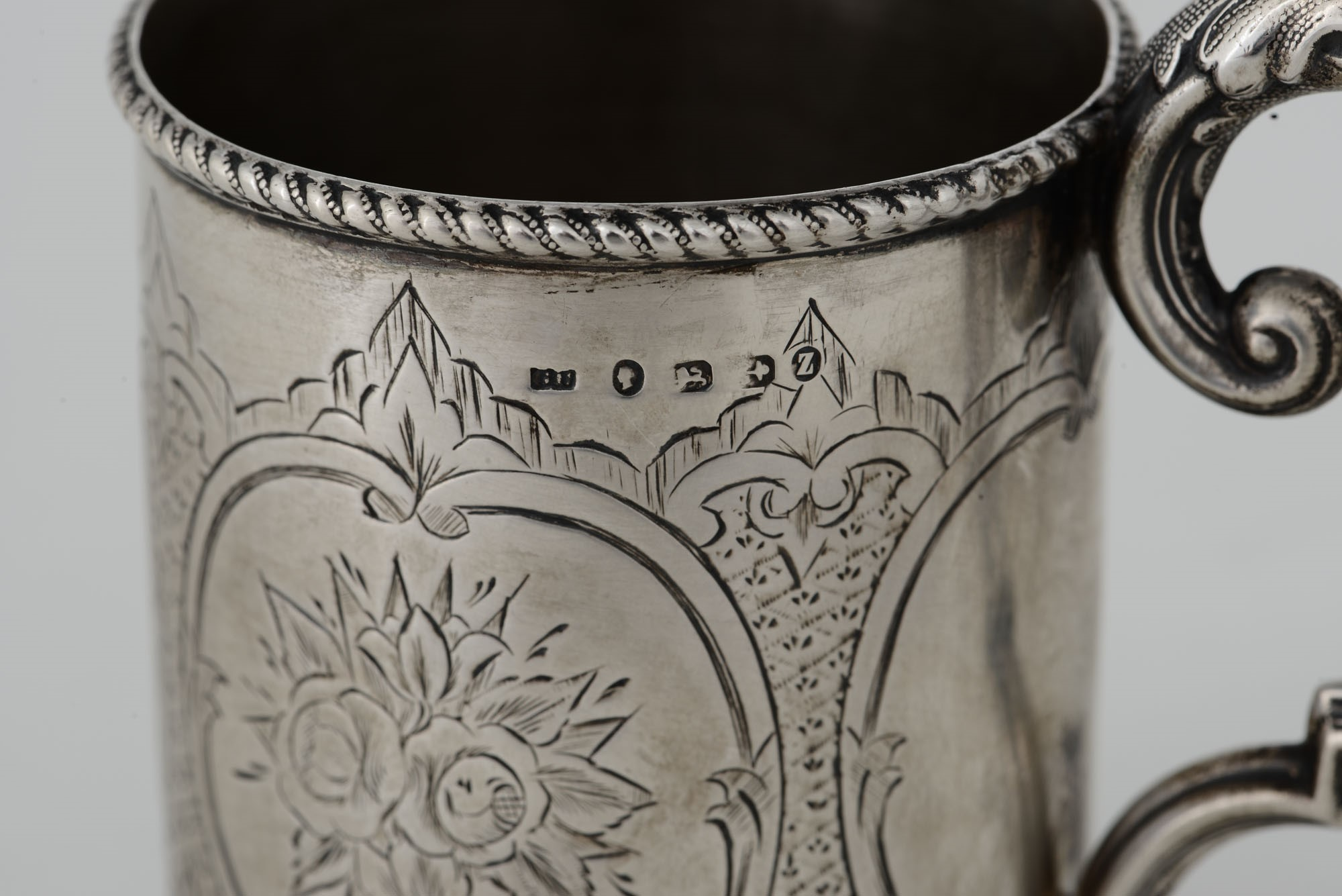 Lot 26 - A christening cup, G. Unite, Birmingham, 1874 - Molten, embossed and chiselled silver -