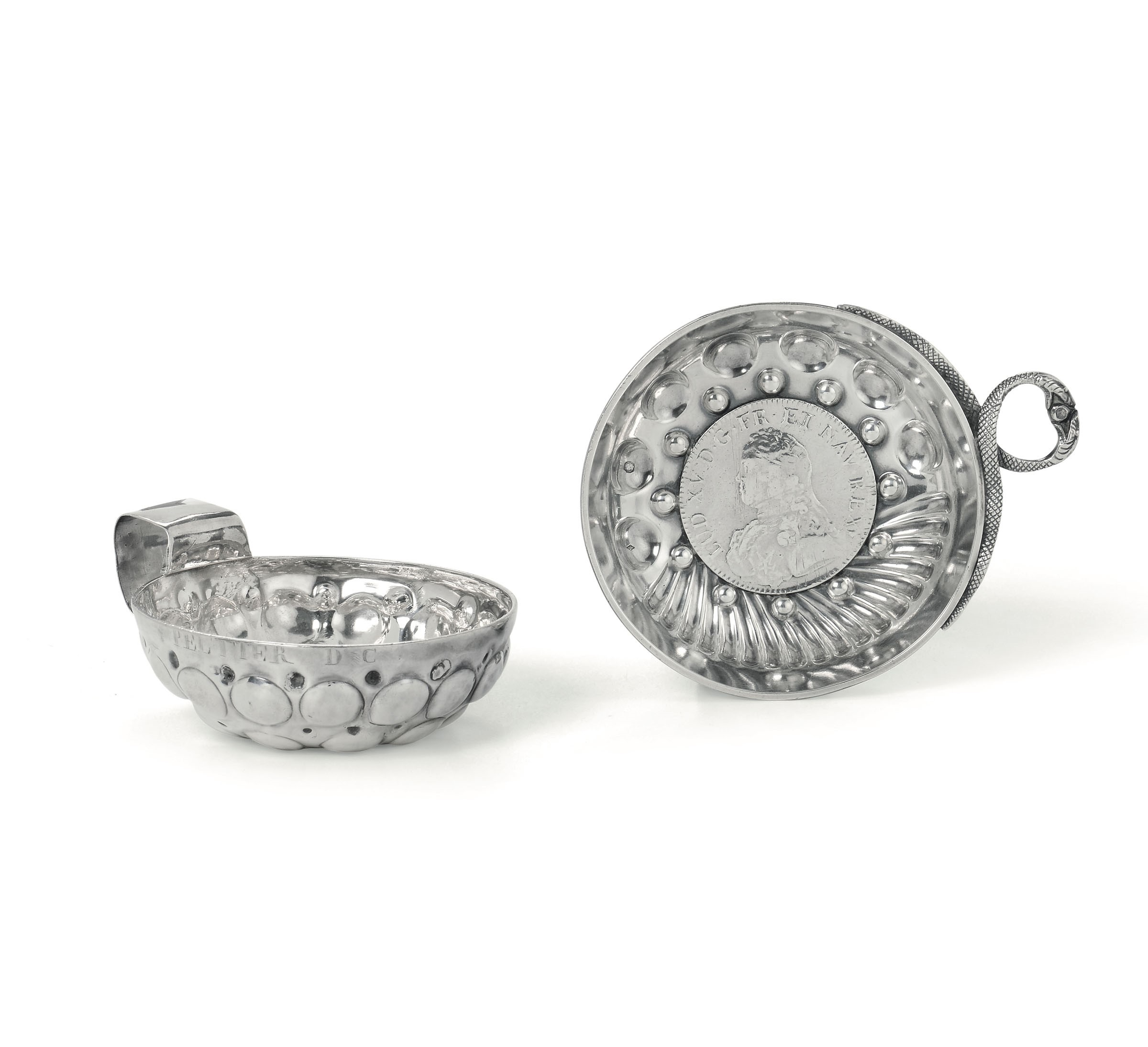 Lot 49 - Two silver tastevins, France (?), 1800s - One with an inlaid coin dated 1728. diam [...]
