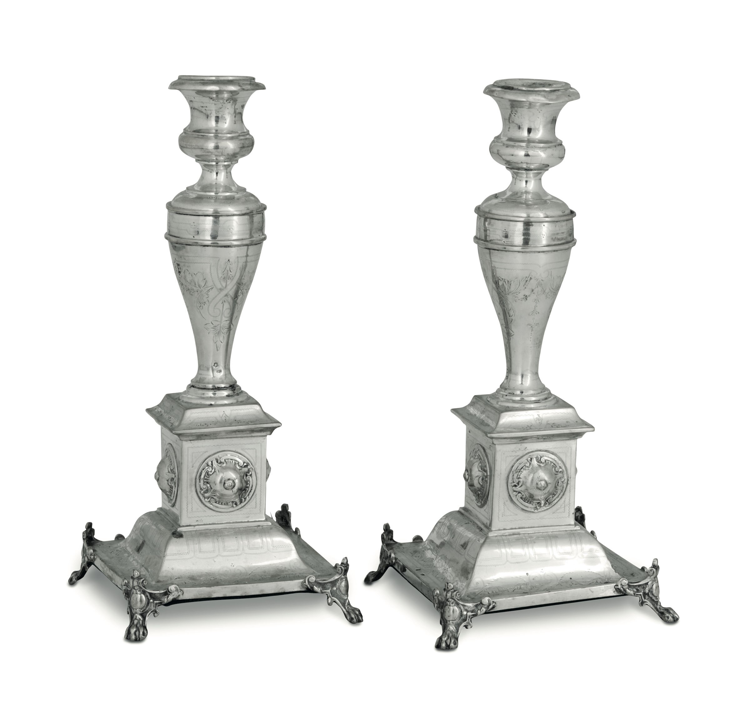 Lot 53 - A pair of candlesticks in molten, embossed and chiselled silver. Austro-Hungarian [...]