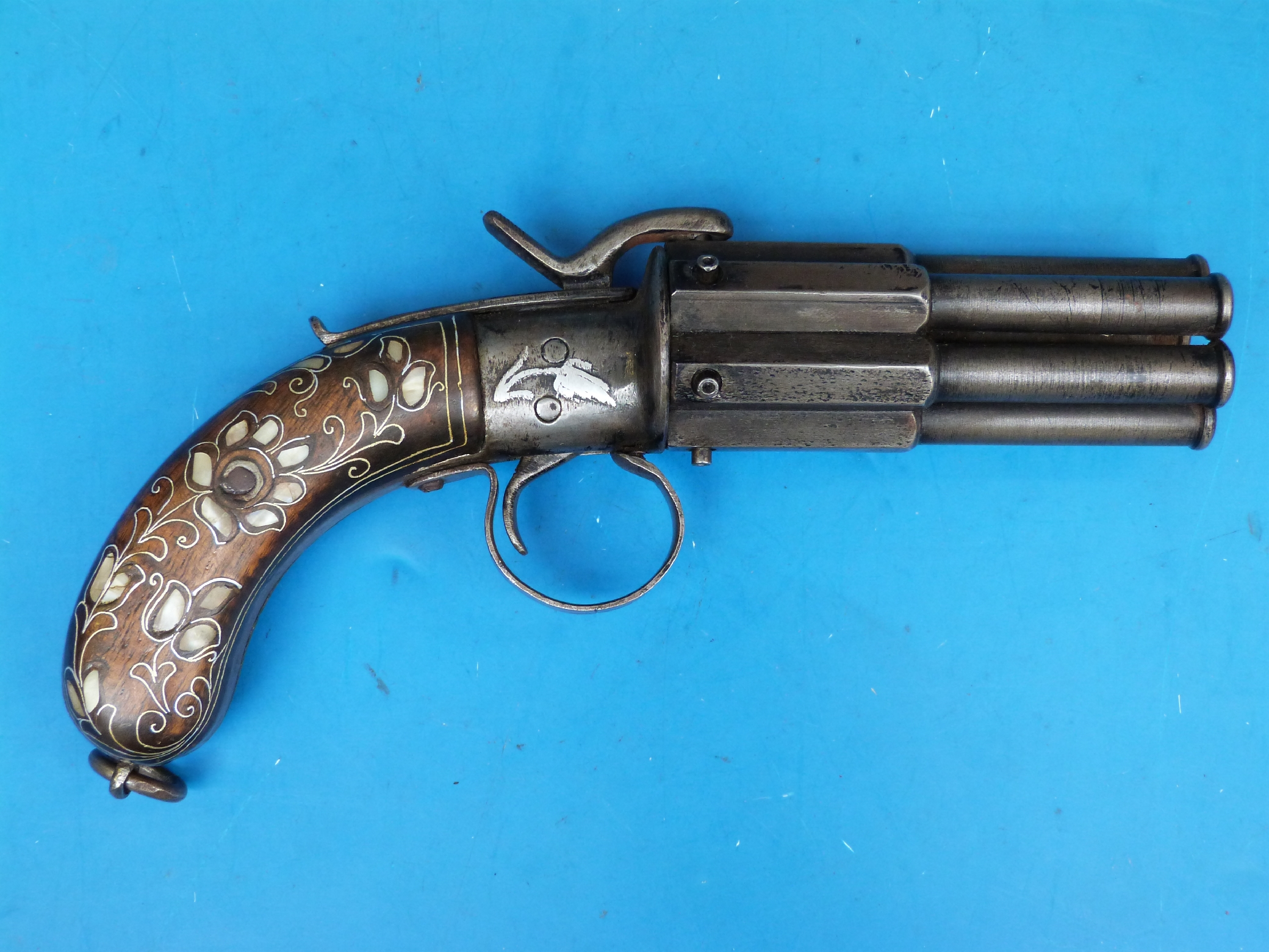 A Turkish pepper box six shot revolver with mother of pearl and wire ...