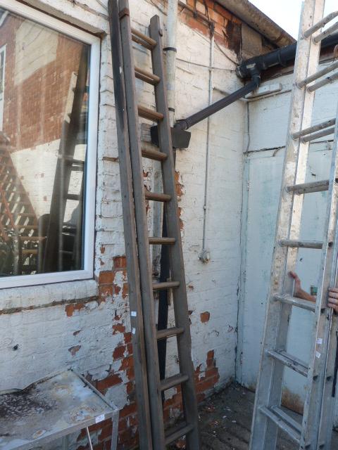 Lot 29 - Extending 22 Tread Wooden Ladder
