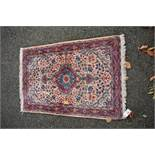 A small Persian rug,with allover floral design, 102 x 70cm.