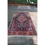 An Iranian rug,having red field with geometric design, 242 x 132cm.