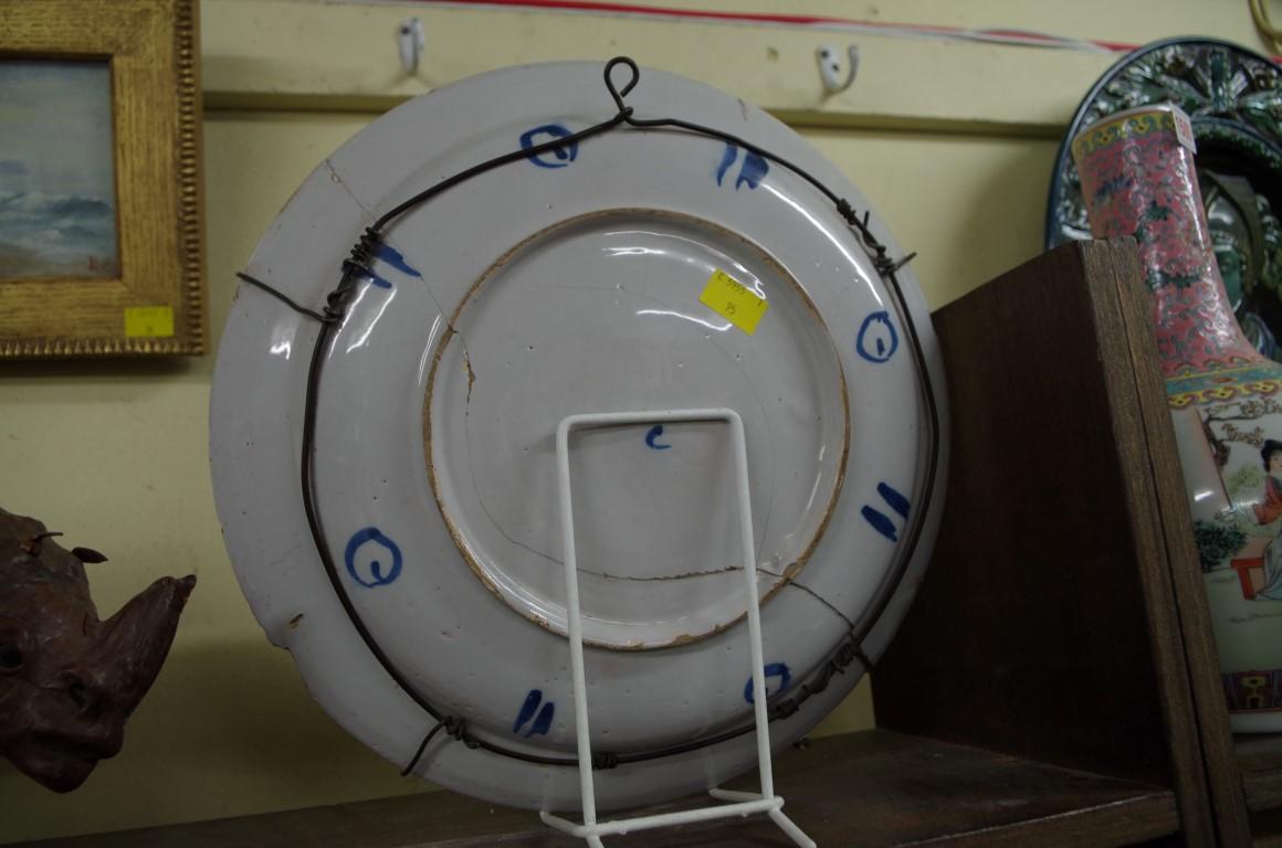 Lot 1577 - An 18th century Continental tin glazed plate,33.5cm diameter.