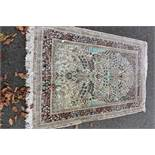An Oriental rug,having beige field with allover floral design, 195 x 120cm.