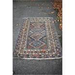 A Bokhara rug,having geometric design, 150 x 113cm.
