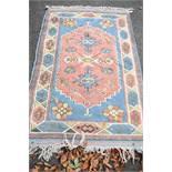 An Eastern rug,having geometric design, 200 x 126cm.