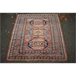 A Persian rug,having three central medallions with floral and geometric borders, 154 x 144cm.