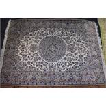 A Persian rug, having central floral medallion, with allover floral field on a cream and beige