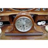 A 1930s mahogany and inlaid Westminster chiming Napolean clock,43cm wide, with pendulum.