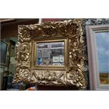 A reproduction gilt framed wall mirror,47 x 52cm.