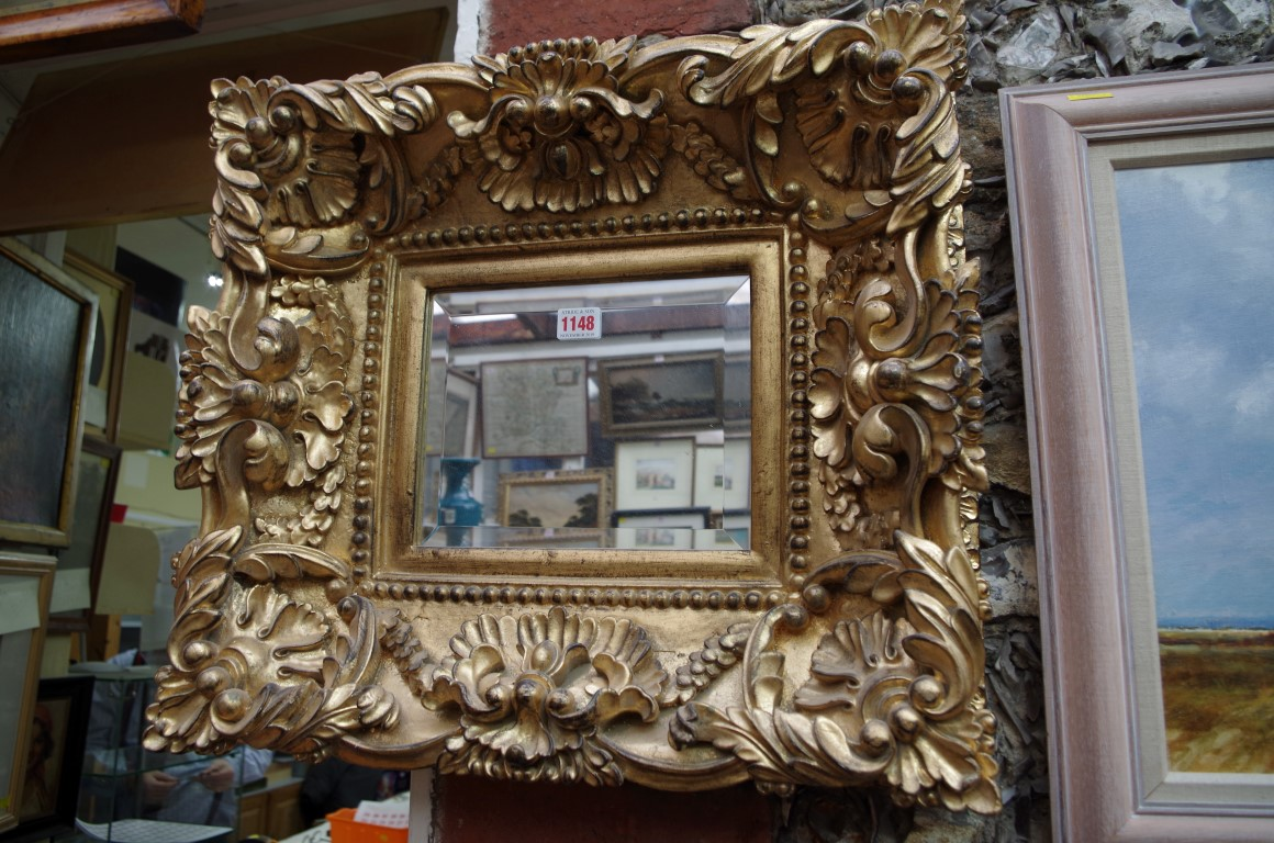 Lot 1148 - A reproduction gilt framed wall mirror, 47 x 52cm.