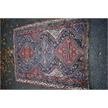 An Eastern rug,having three central medallions, with floral central field and geometric borders,