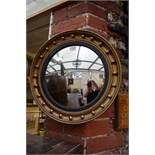 A reproduction gilt framed convex wall mirror, 41.5cm diameter.