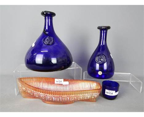 Three pieces of Kastrup-Holmegaard cobalt blue glass and a carnival glass model of a boat. [4]