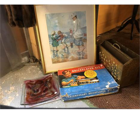 A FRAMED SEASIDE PRINT, A CHILD'S BRICKLAYER KIT AND A LARGE SQUARE RED GLASS PLATTER