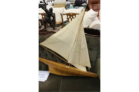 A pond yacht, circa 1940s with stand, original sails and