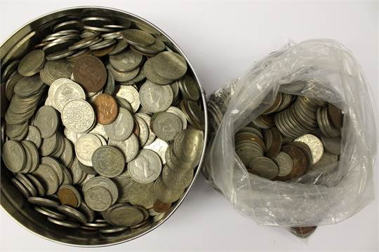 A tin and bag of coins (2)