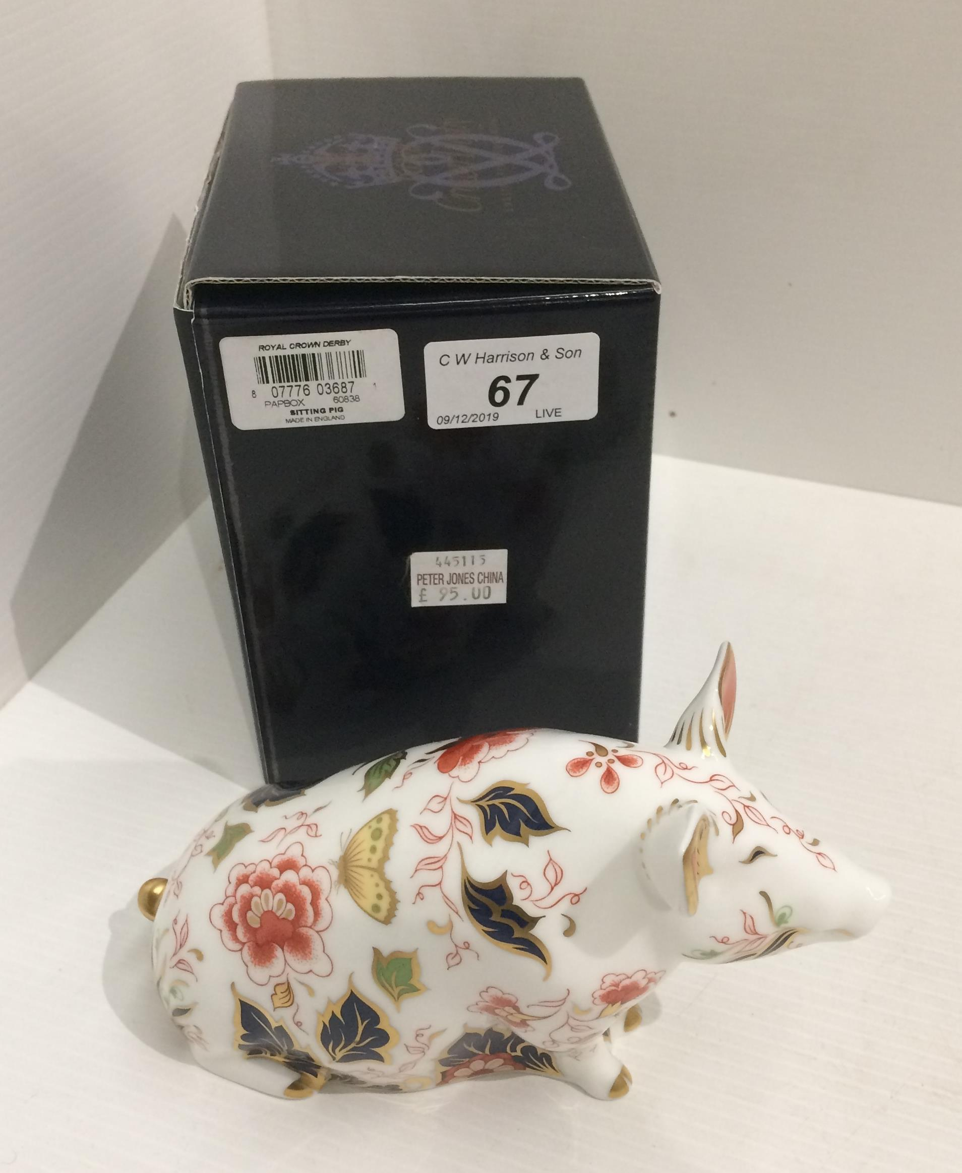 Lot 67 - A Royal Crown Derby bone china Sitting Pig paperweight - 18cm long,