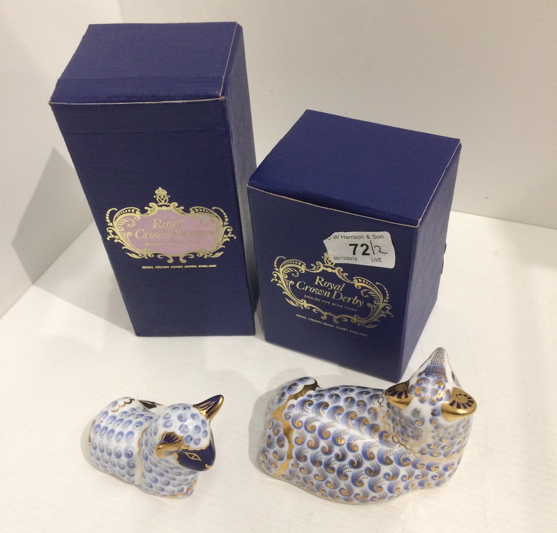 Lot 72 - Two Royal Crown Derby bone china paperweights - Sheep - 12cm long and Baby Lamb - 9cm long,