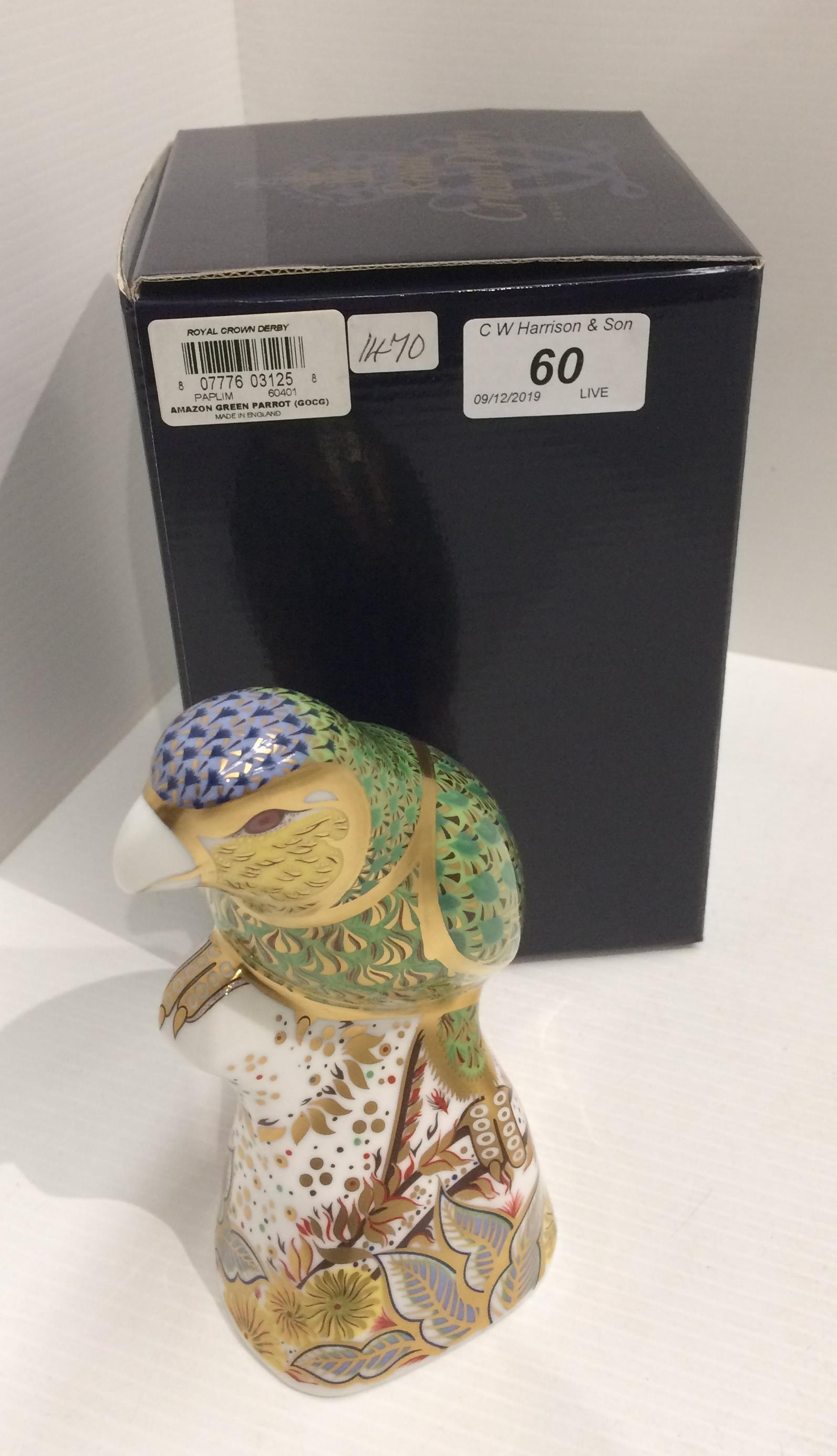 Lot 60 - A Royal Crown Derby bone china specially commissioned edition Amazon Green Parrot paperweight -
