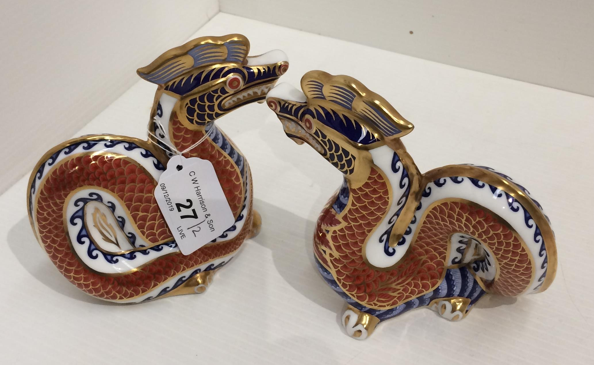 Lot 27 - Two Royal Crown Derby bone china Dragon paperweights 12cm high (2)