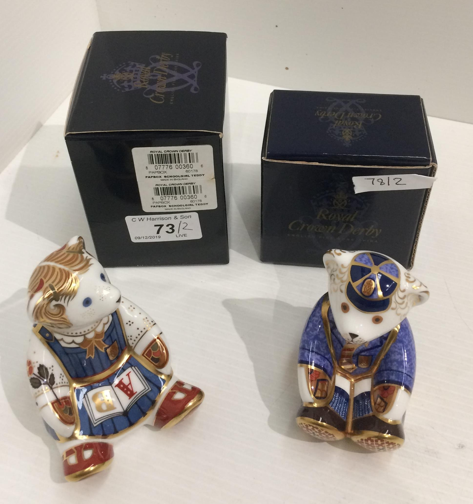 Lot 73 - Two Royal Crown Derby bone china paperweights - Schoolboy Teddy and Schoolgirl Teddy, both 8.