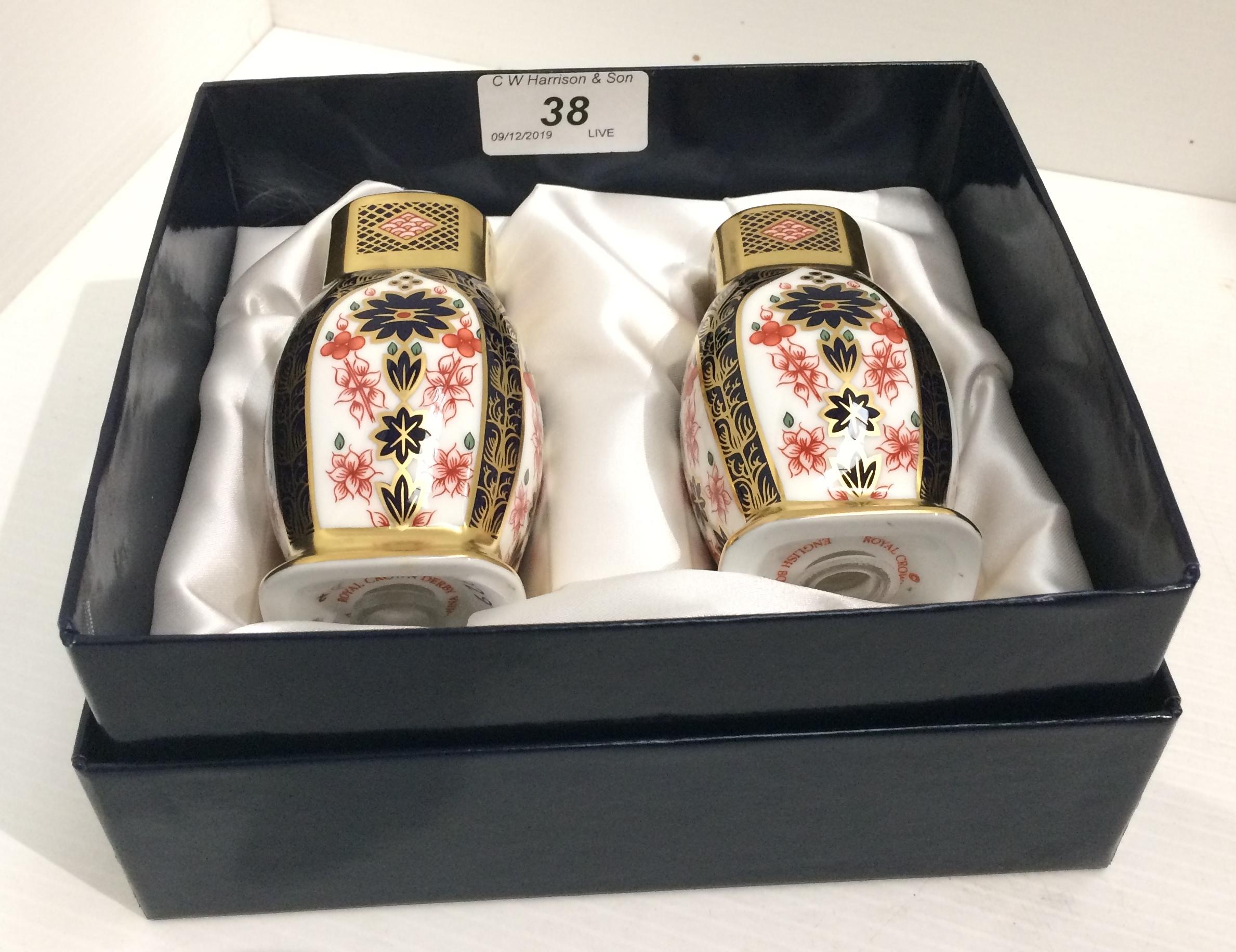 Lot 38 - A Royal Crown Derby bone china two piece cruet set (salt and pepper) - boxed