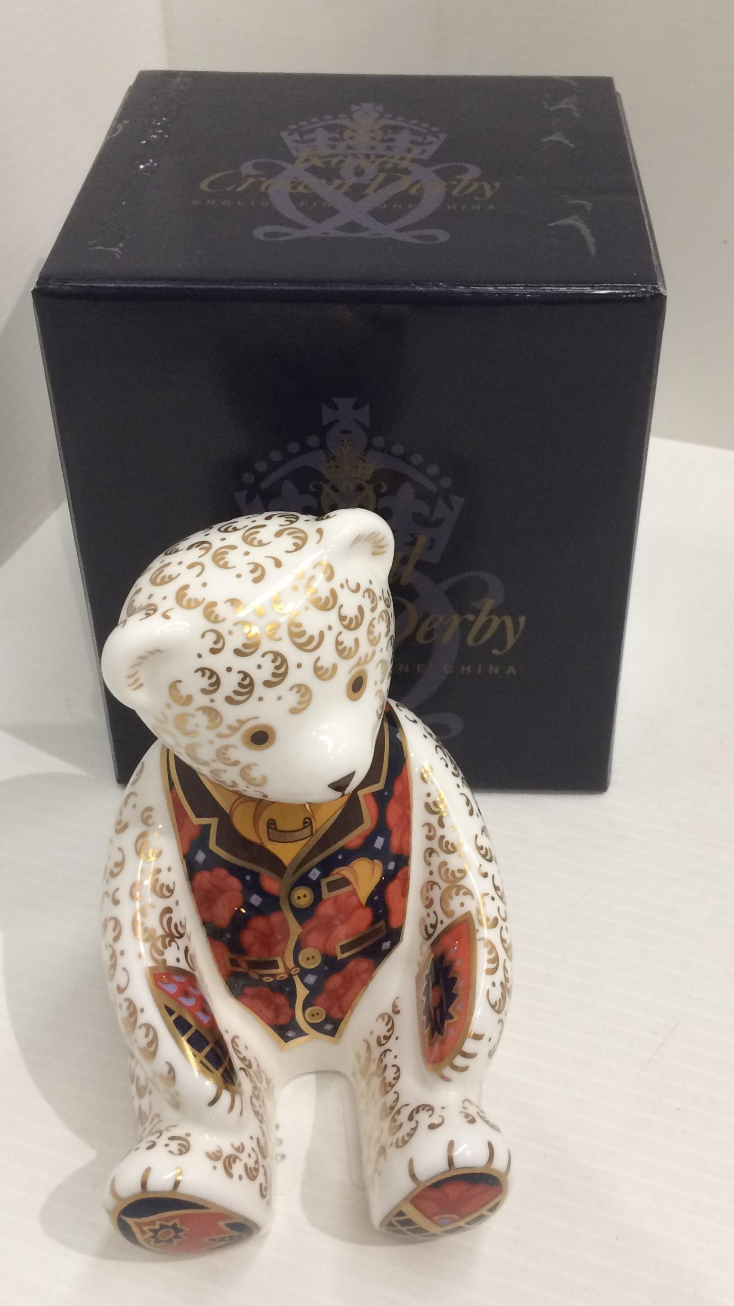 Lot 57 - A Royal Crown Derby bone china Collectors Guild Exclusive Teddy Bear paperweight - 12cm high,